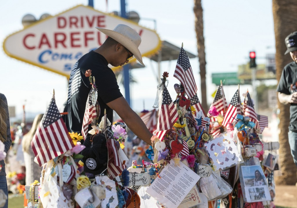 FILE - In this Nov. 10, 2017, file photo, Route 91 Harvest shooting survivor Jason Zabala of San Diego, Calif., visits the memorial for victims of the