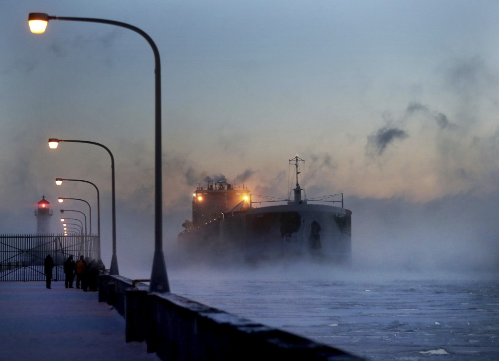 Steam rises from Lake Superior as the ship St. Clair comes to harbor during some of the coldest temps of the year, Sunday, Dec. 31, 2017, at Canal Par