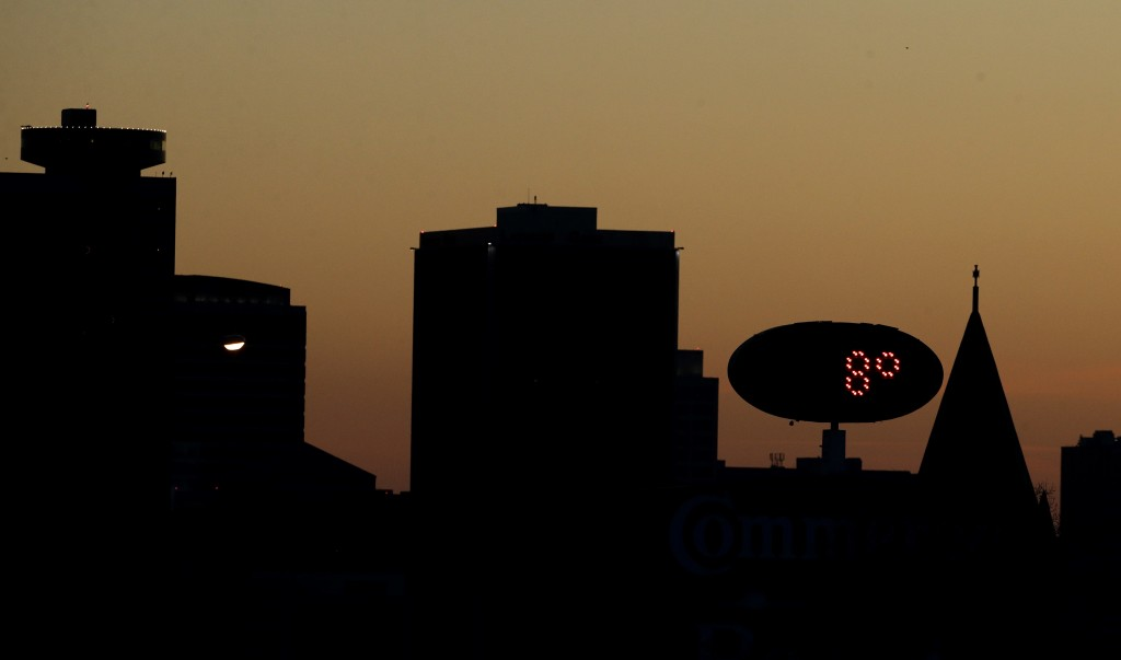 Temperatures approach the high for the day 8 Fahrenheit (-13 Celsius) as the sun sets Monday, Jan. 1, 2018, behind downtown Kansas City, Mo. Bone-chil