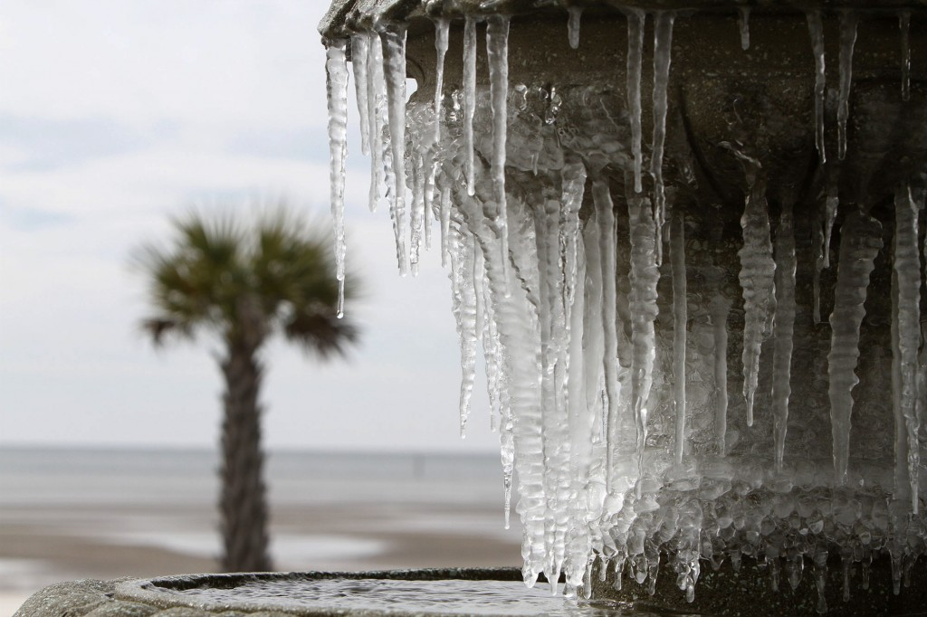 Icicles hang from the fountain at Beau View condominiums in Biloxi, Miss., on Monday, Jan. 1, 2018. A hard freeze hit South Mississippi overnight and