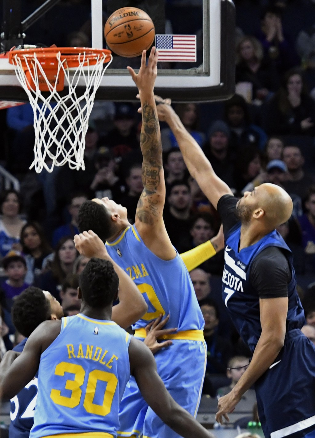 2377c6ee290 Minnesota Timberwolves' Taj Gibson,right, tries unsuccessfully to block a  shot by Los