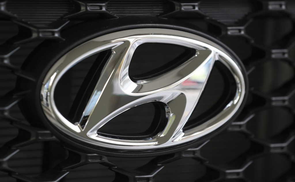 FILE - In this Oct. 26, 2017, file photo, the logo of Hyundai Motor Co. is seen on a car displayed at the automaker's showroom in Seoul, South Korea. ...