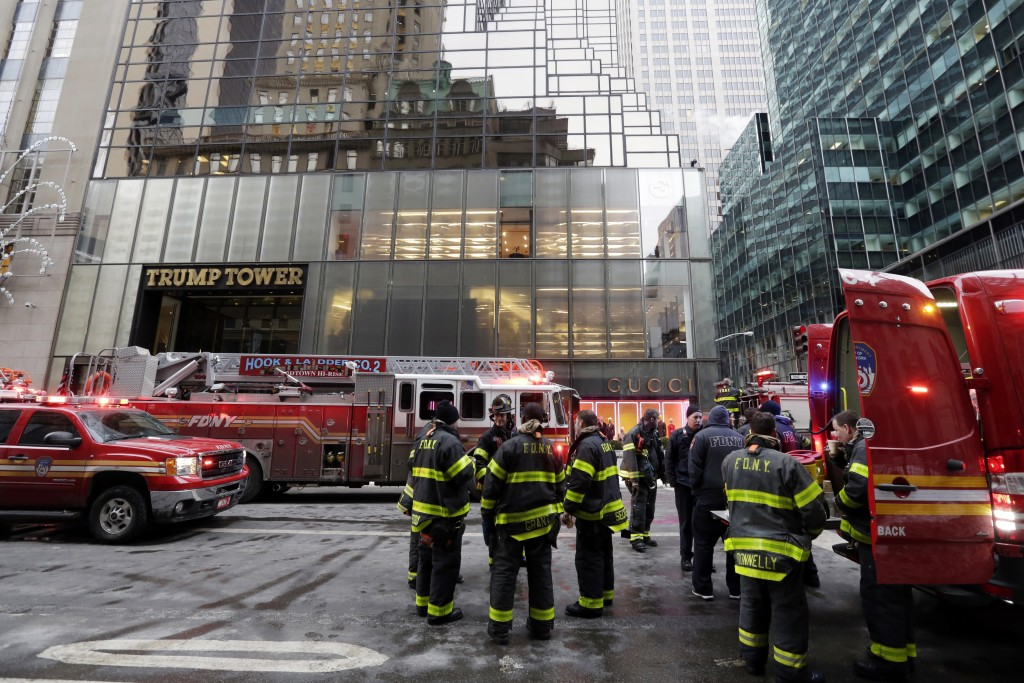 Fire breaks out atop NY's Trump Tower injuring three