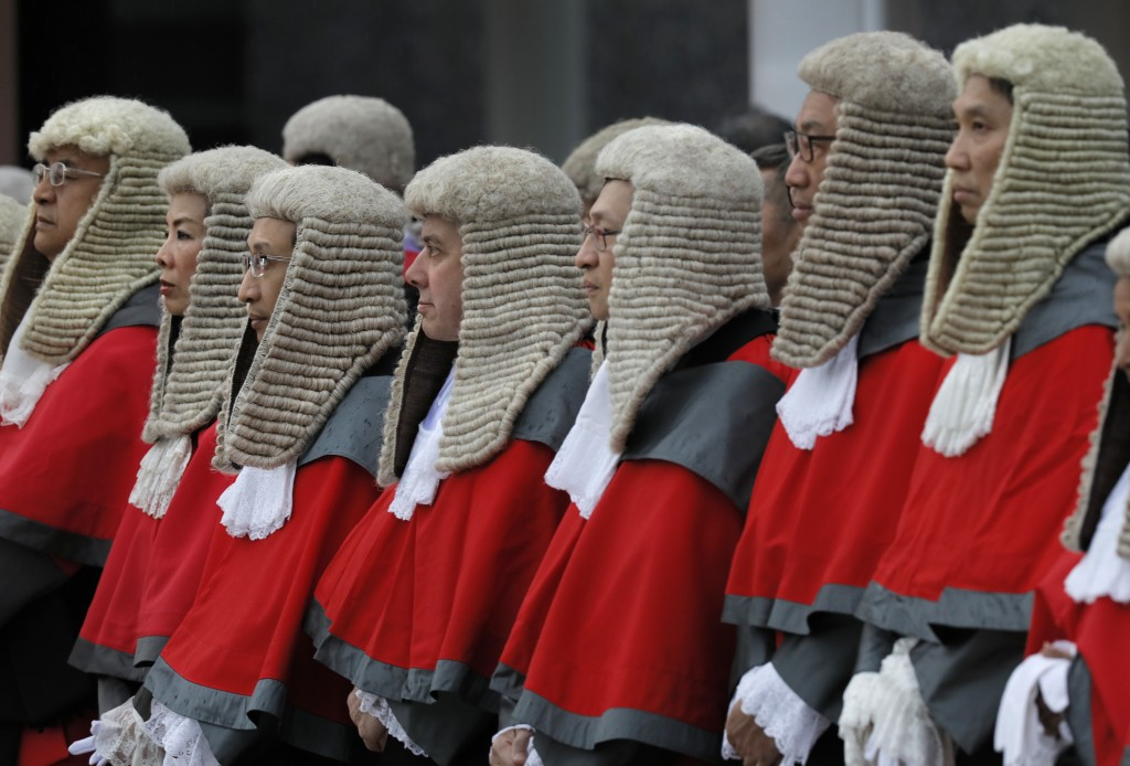 In this Monday, Jan. 8, 2018, file photo, Hong Kong judges don wigs and robes attend the opening of the legal year at City Hall in Hong Kong. (AP Phot