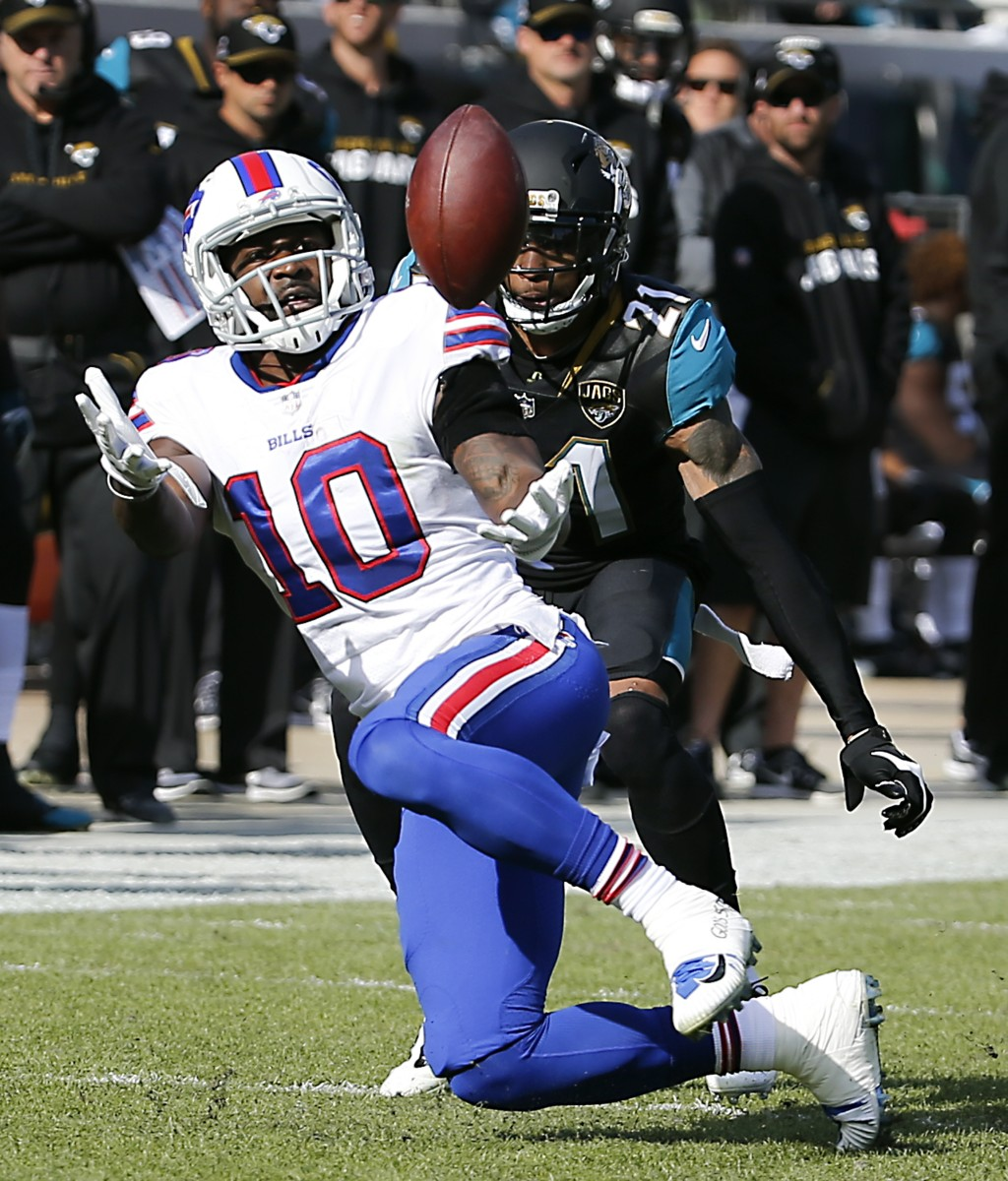 Jacksonville Jaguars cornerback A.J. Bouye right breaks up a pass intended for Buffalo Bills wide receiver Deonte Thompson in the first half