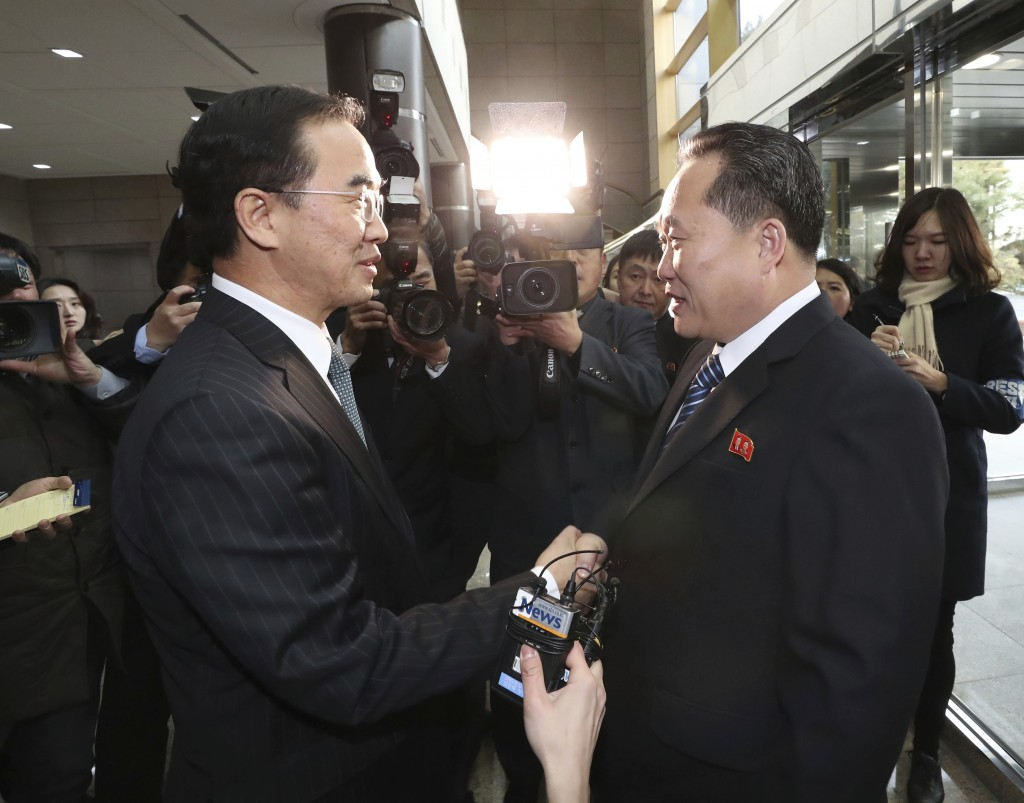 In this Tuesday, Jan. 9, 2018, file photo, South Korean Unification Minister Cho Myoung-gyon, left, shakes hands with the head of North Korean delegat