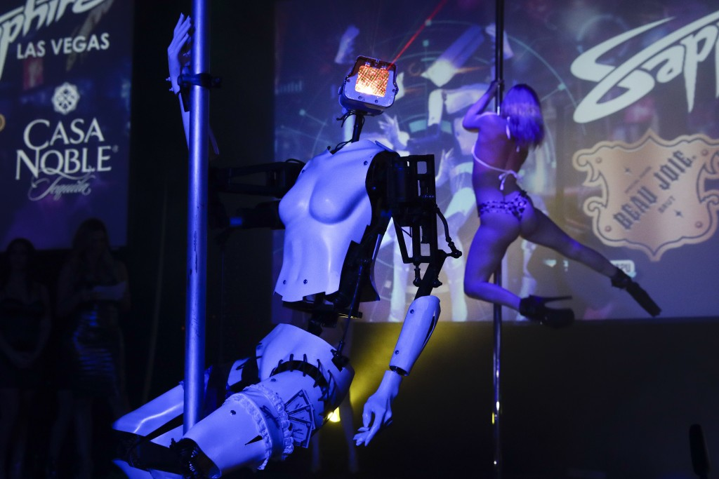 A pole-dancing robot built by British artist Giles Walker performs at a gentlemen's club Monday, Jan. 8, 2018, in Las Vegas. The event was held to coi