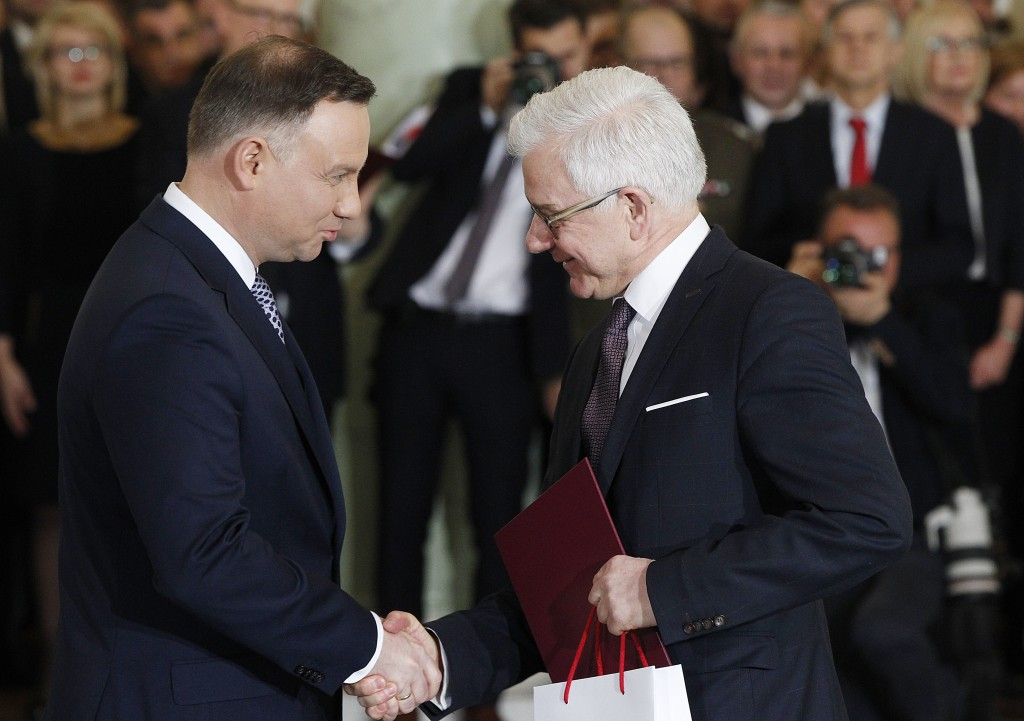Poland's President Andrzej Duda, left, takes the oath from new Foreign Minister Jacek Czaputowicz in the government of Prime Minister Mateusz Morawiec