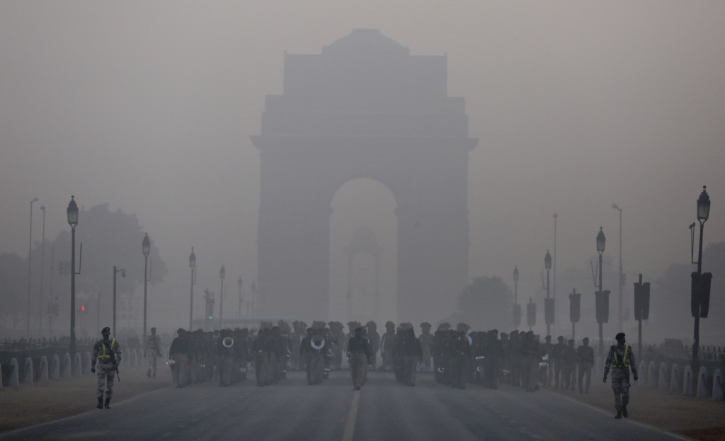 In this Tuesday, Jan. 9, 2018, file photo, an Indian paramilitary contingent march in front of India Gate, the landmark war memorial during rehearsals