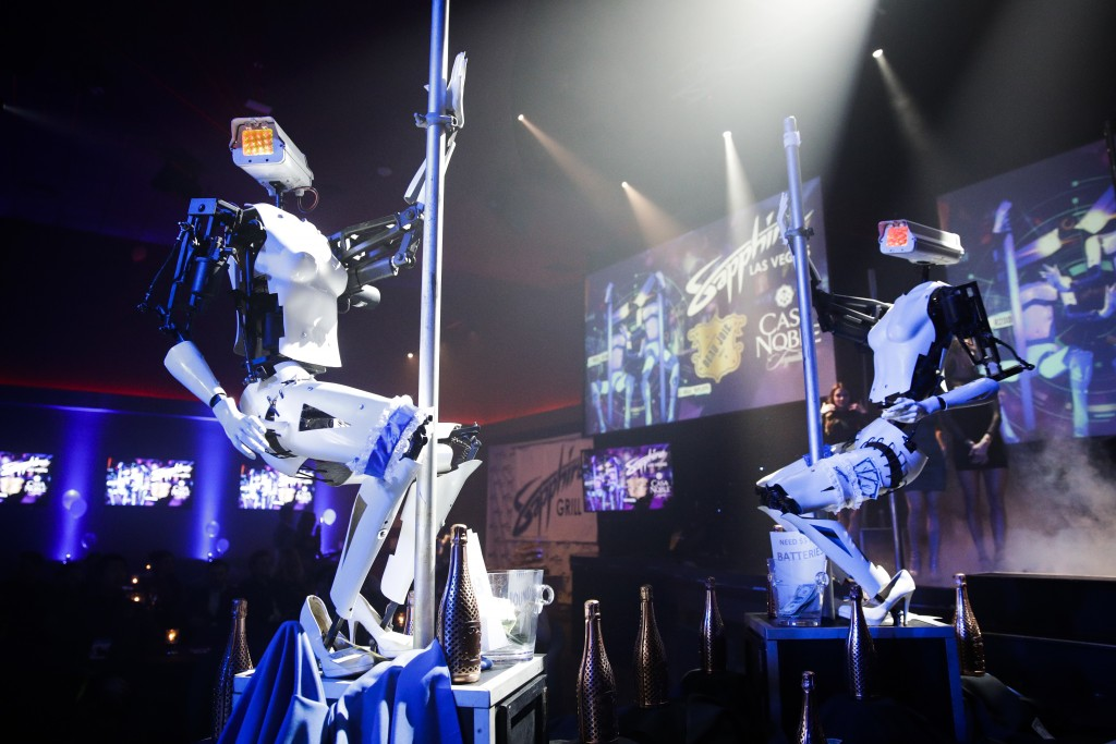 Two pole-dancing robots built by British artist Giles Walker perform at a gentlemen's club Monday, Jan. 8, 2018, in Las Vegas. The event was held to c