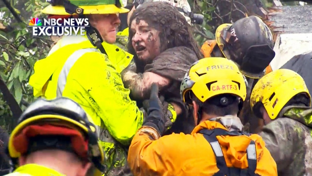 This frame from video provided by NBC News shows the rescue of a 14-year-old girl from the wreckage of a home after heavy rains trapped dozens of peop