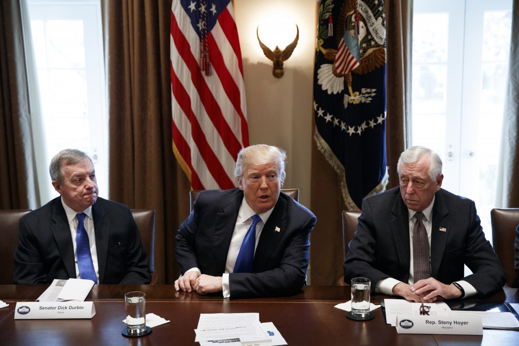 In this Jan. 9, 2017, photo, Sen. Dick Durbin, D-Ill., left, and Rep. Steny Hoyer, D-Md. listen as President Donald Trump speaks during a meeting with