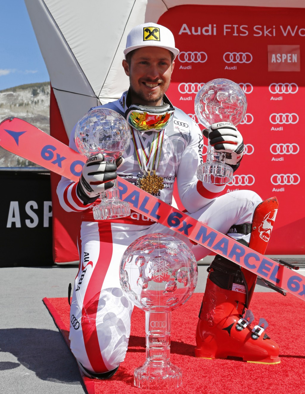FILE - In this March 19, 2017, file photo, World Cup overall men's 2017 champion Austria's Marcel Hirscher poses with his crystal globe trophies after