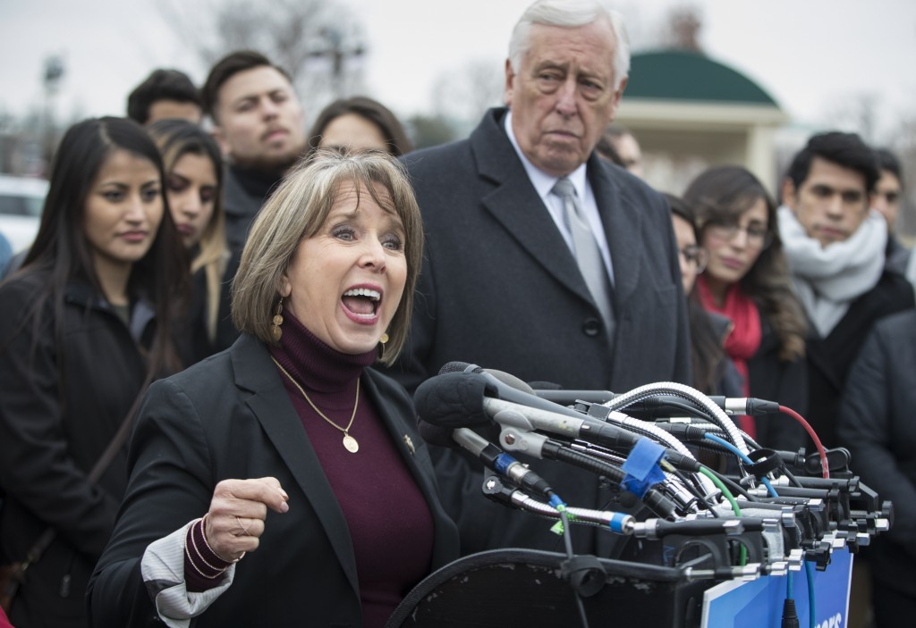 "Hispanic Caucus Chair Rep. Michelle Lujan Grisham, D-N.M., joined at right by House Minority Whip Steny Hoyer, D-Md., gives her support to ""dreamers,"""