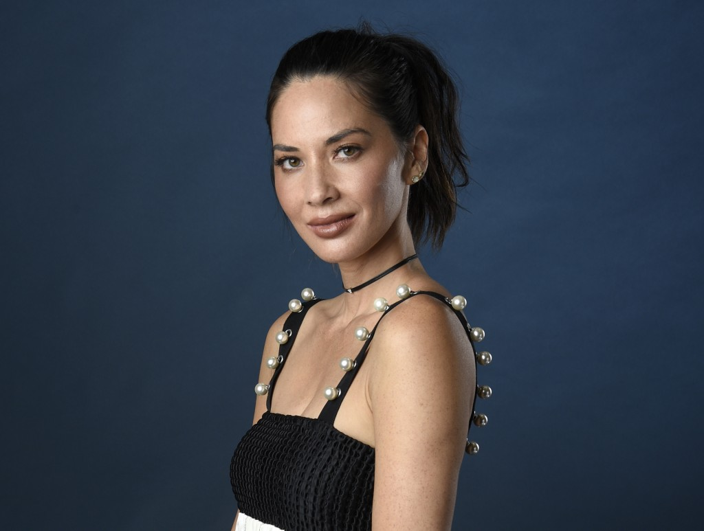 FILE - In this July 21, 2017 file photo, actress Olivia Munn poses for a portrait at Comic-Con International in San Diego. Munn is hosting the Critics