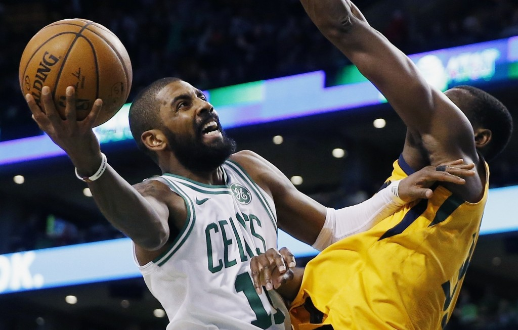 FILE - In this Dec. 15, 2017, file photo, Boston Celtics' Kyrie Irving (11) shoots against Utah Jazz's Ekpe Udoh during the fourth quarter of an NBA b