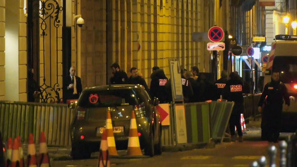 In this image made from video, French police attend the scene outside the Ritz Hotel in Paris, France, after a robbery Wednesday evening Jan. 10, 2018