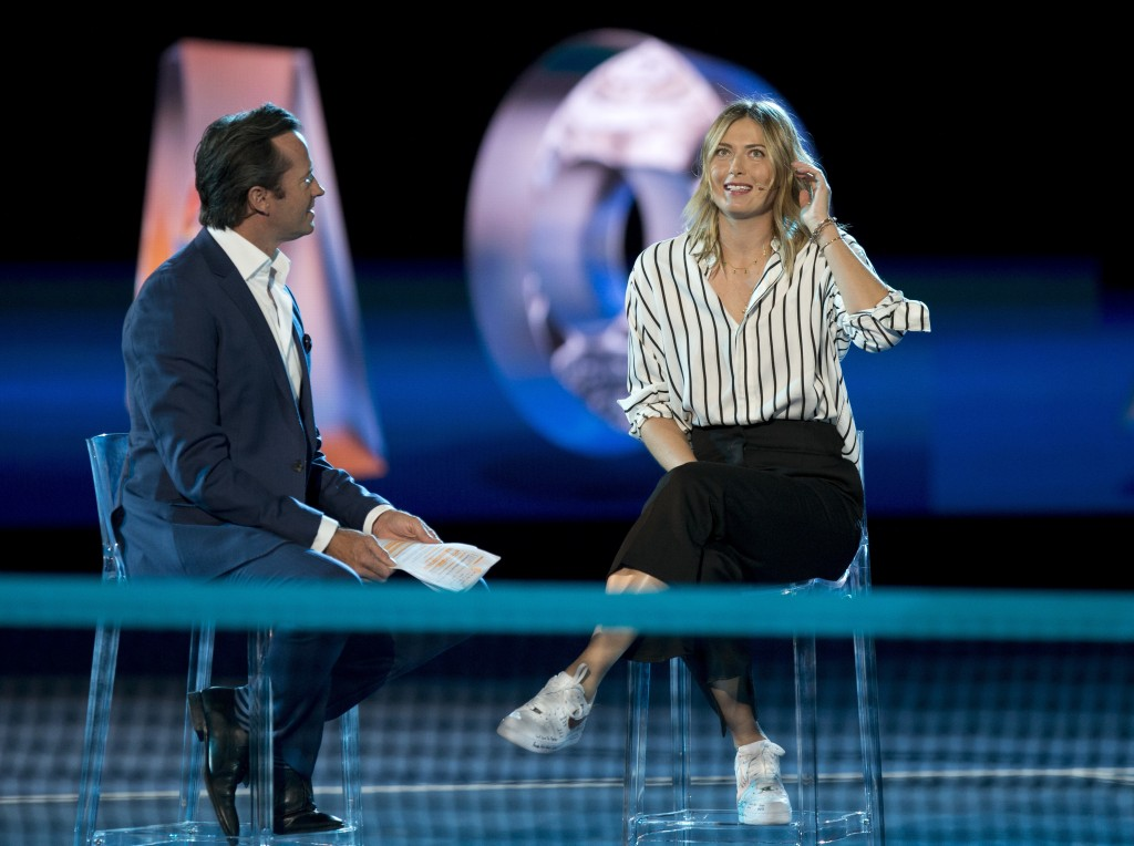 Former ladies single's champion Russia's Maria Sharapova is interviewed on Margaret Court Arena during the ceremony for the official draw at the Austr