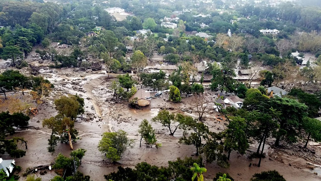 This aerial photo provided by the Santa Barbara County Fire Department shows mudflow and damage to homes in Montecito, Calif., Wednesday, Jan. 10, 201