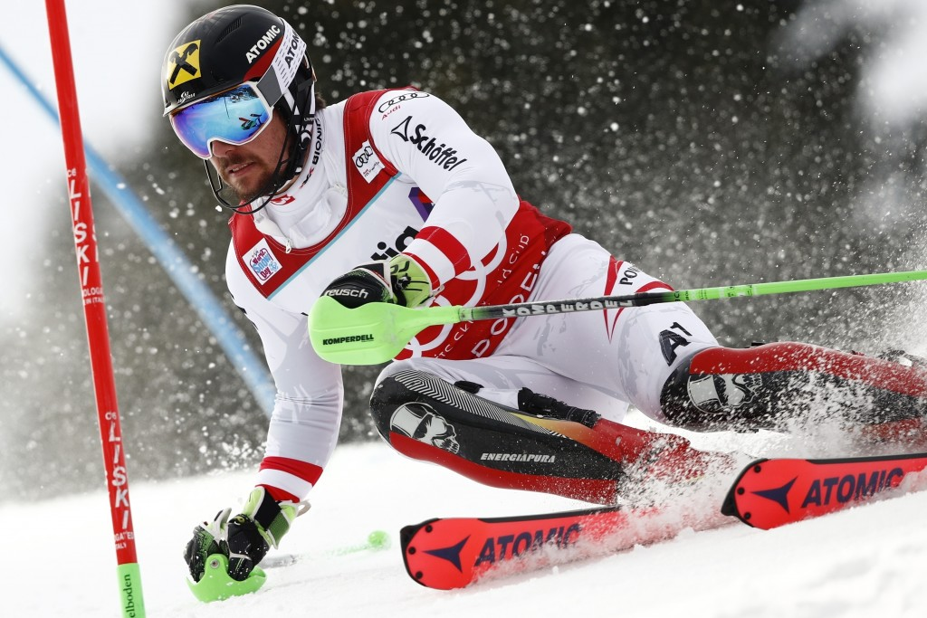FILE - In this Jan. 7, 2018, file photo, Austria's Marcel Hirscher competes during an alpine ski, men's World Cup slalom in Adelboden, Switzerland. Hi