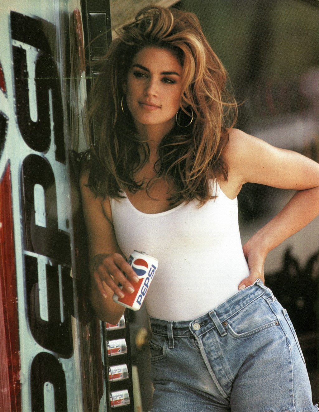 This image released by Pepsi shows actress-model Cindy Crawford in a scene from her 1992 iconic Super Bowl Pepsi commercial. Crawford returns for anot