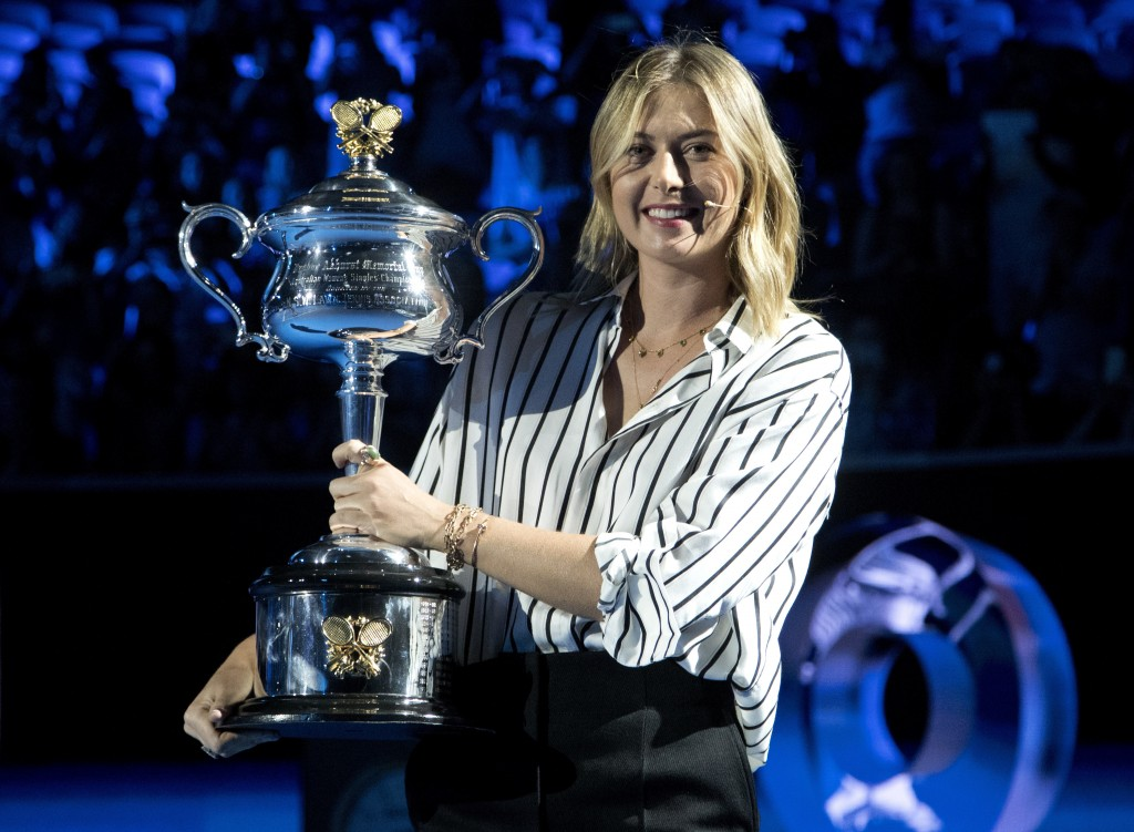 Former ladies single's champion Russia's Maria Sharapova poses for a photo with the Daphne Akhurst Memorial Cup on Margaret Court Arena during the cer