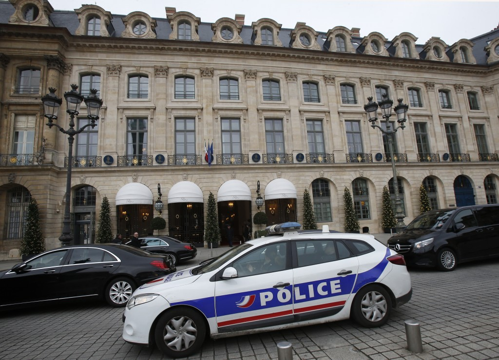 A police car drives past the Ritz hotel in Paris, Thursday, Jan. 11, 2018. Paris police have recovered some jewels stolen from the Ritz Hotel in a mul