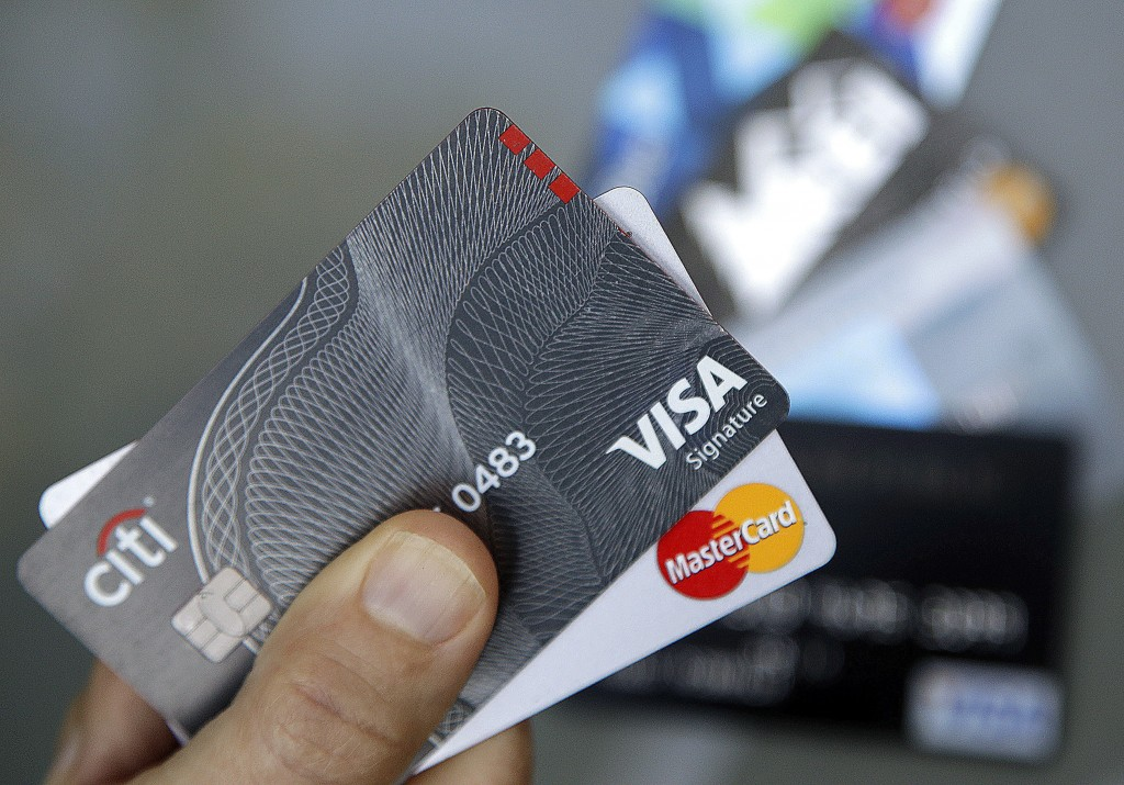 FILE - In this June 15, 2017, file photo, credit cards are displayed in Haverhill, Mass. If you have excellent credit, you can use your credit rating