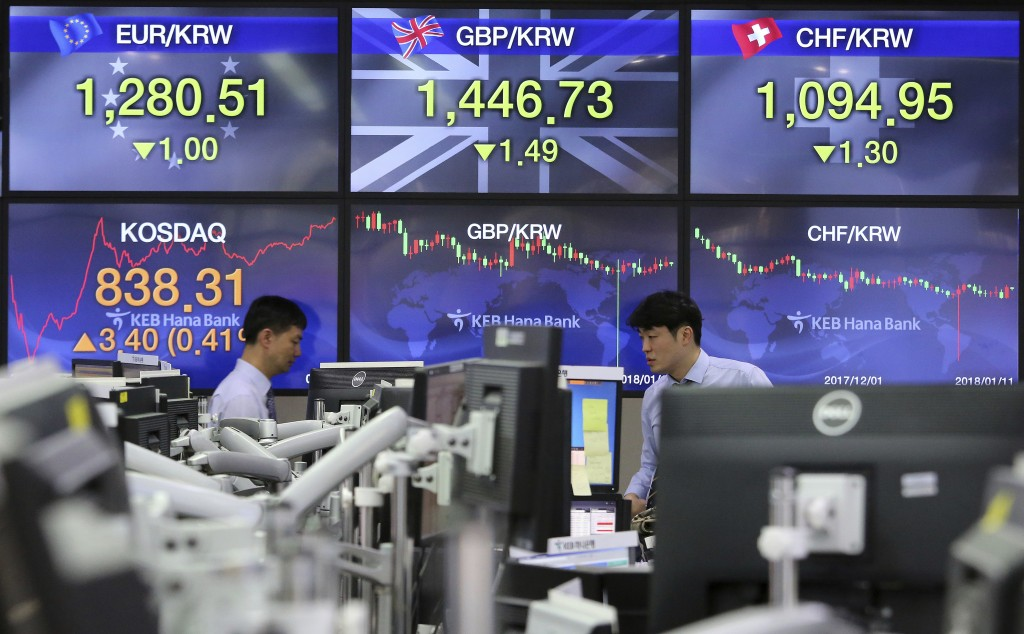 Currency traders work at the foreign exchange dealing room of the KEB Hana Bank headquarters in Seoul, South Korea, Thursday, Jan. 11, 2018. Asian sto