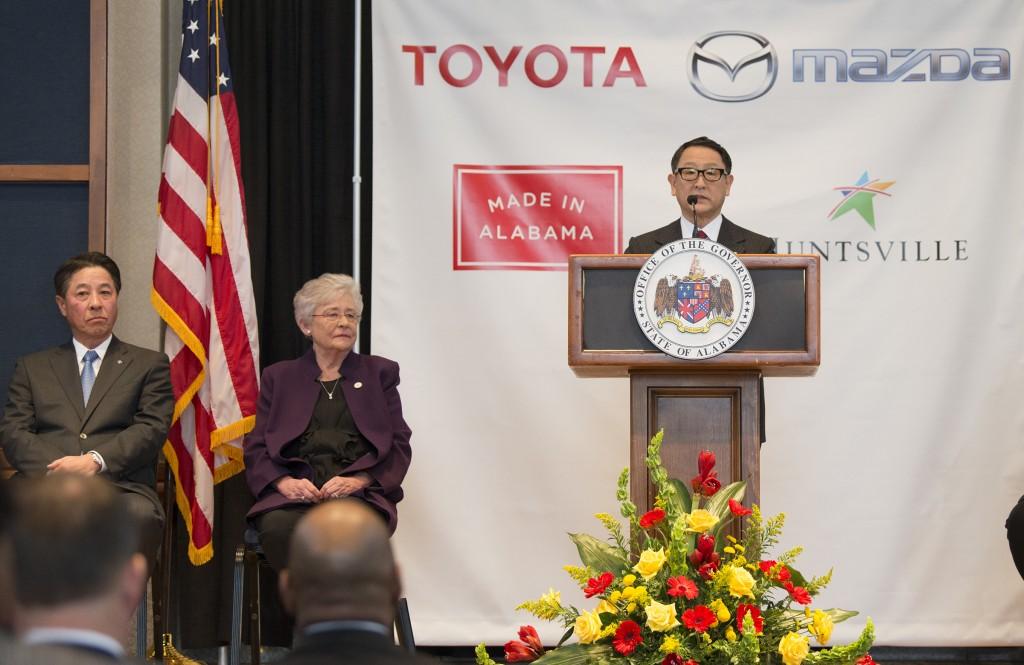 Akio Toyoda, right, Toyota Motor Corp., speaks as Alabama Gov. Kay Ivey, center, Masamichi Kogai, Mazda Motor Corp. president and CEO,  listen during