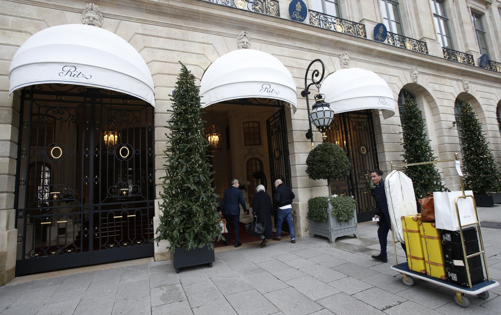 People enter the Ritz hotel in Paris, Thursday, Jan. 11, 2018. Paris police have recovered some jewels stolen from the Ritz Hotel in a multimillion-eu