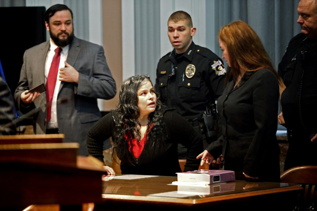 FILE - In this Jan. 9, 2018, file photo, Juanita Gomez speaks to her attorney in Oklahoma County District Court in Oklahoma City. A jury on Thursday,