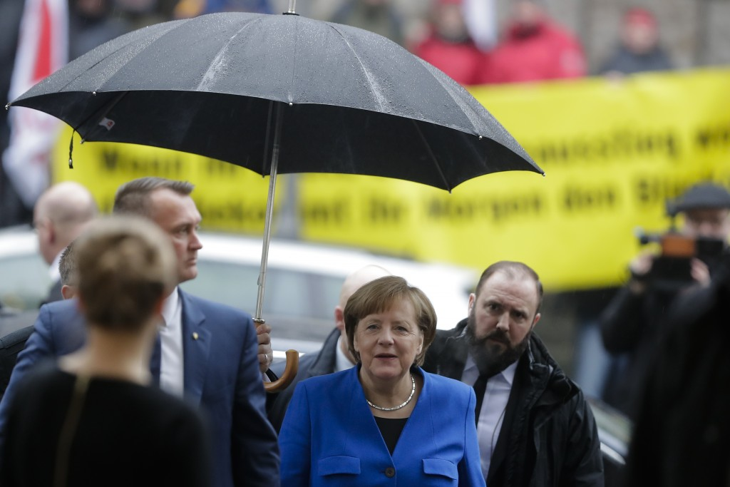 German Chancellor Angela Merkel, center, arrives for exploratory talks about a new German government between her Christian Unions block and the Social