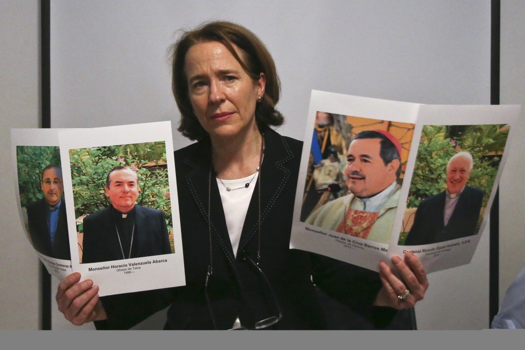 Anne Barrett Doyle, co-director of BishopAccountability.org, a U.S.-based group that has compiled a clergy abuse database, shows images of Catholic cl