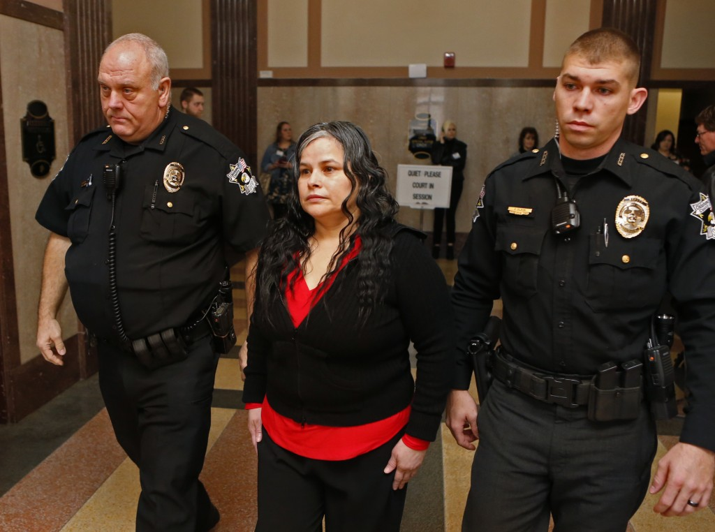 FILE - In this Jan. 9, 2018, file photo, Juanita Gomez is led into Oklahoma County District Court in Oklahoma City. A jury on Thursday, Jan. 11, 2018,