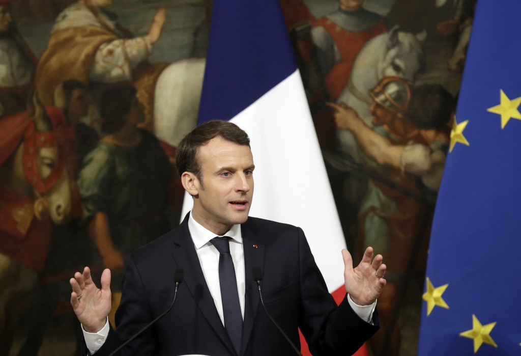 French President Emmanuel Macron speaks during a press conference with Italian Premier Paolo Gentiloni following their meeting at Chigi Palace, in Rom