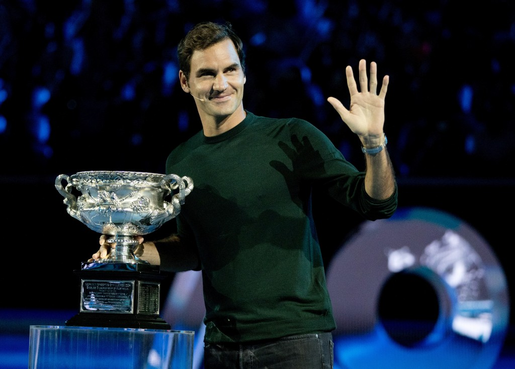 Defending men's singles champion Switzerland's Roger Federer waves to the crowd during a ceremony for the official draw at the Australian Open tennis