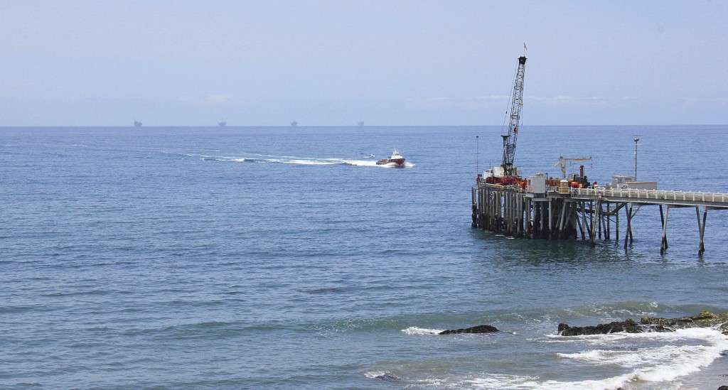 FILE- This May 16, 2015, file photo shows oil drillings offshore of a service pier in the Santa Barbara Channel off the coast of Southern California n