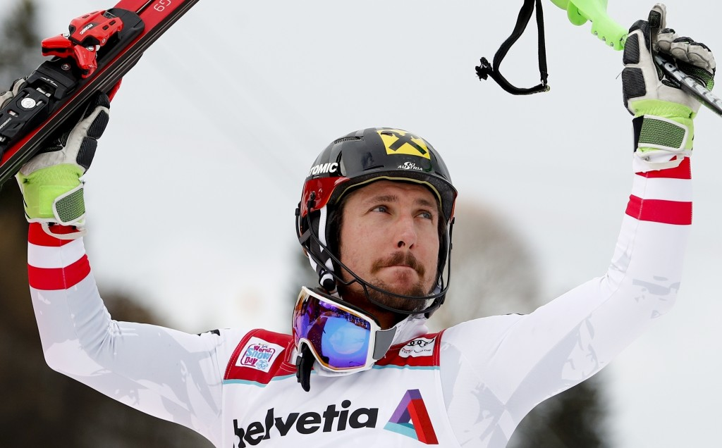 FILE - In this Jan. 7, 2018, file photo, Austria's Marcel Hirscher celebrates after winning an alpine ski, men's World Cup slalom in Adelboden, Switze