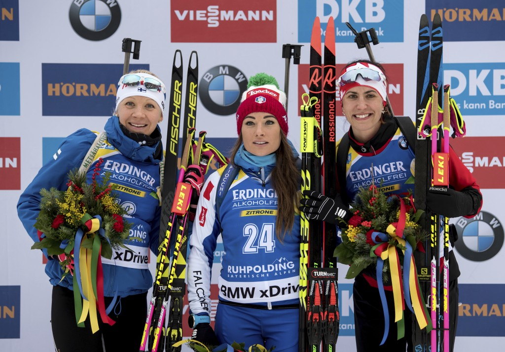 From left:  Finland's second placed Kaisa Makarainen, Italian winner Dothea Wierer, and Canada's third placed Rosanna Crawford celebrate on the podium