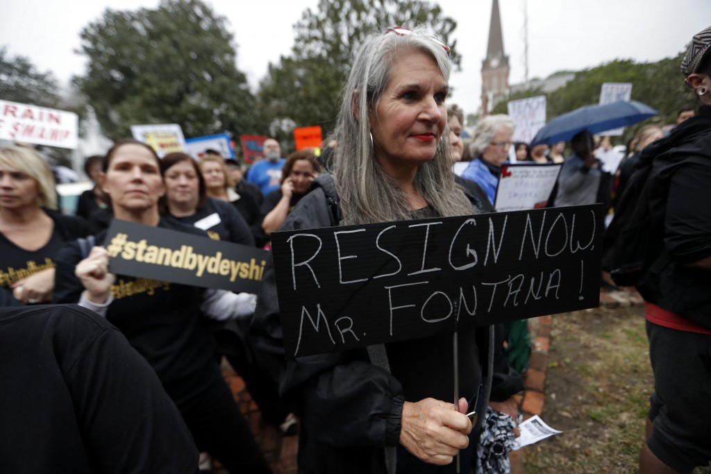 Jennifer Meaux holds a sign at a rally for school teacher Deyshia Hargrave, who was arrested while speaking against the superintendent's pay raise at