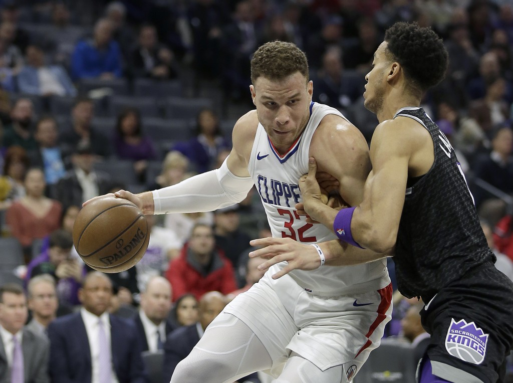 Los Angeles Clippers forward Blake Griffin, left, goes to the basket against Sacramento Kings forward Skal Labissiere during the first quarter of an N