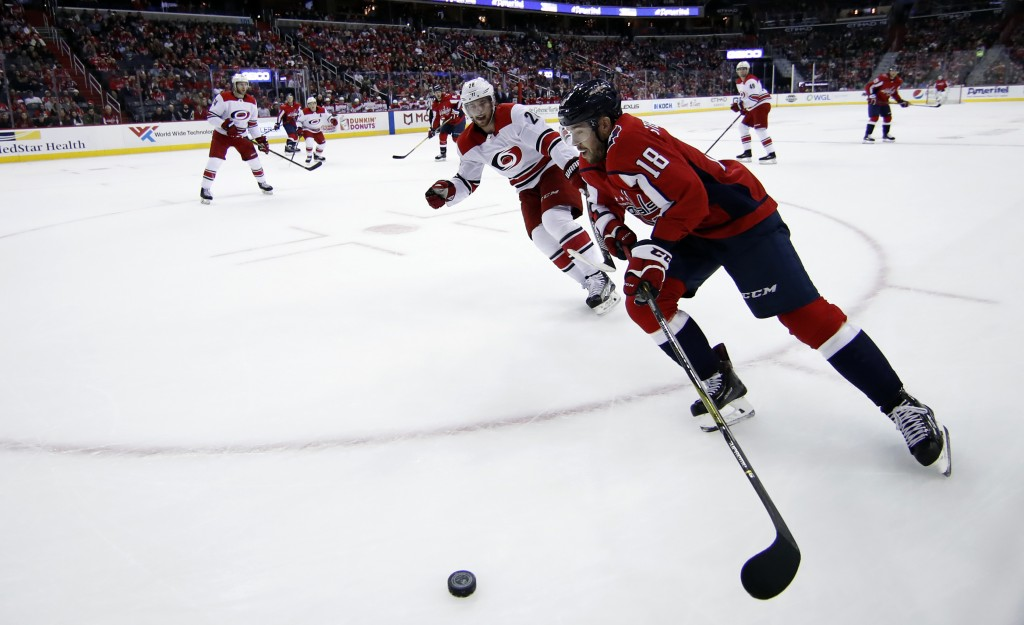 Carolina Hurricanes center Elias Lindholm (28), from Sweden, pursues Washington Capitals center Chandler Stephenson (18) in the first period of an NHL
