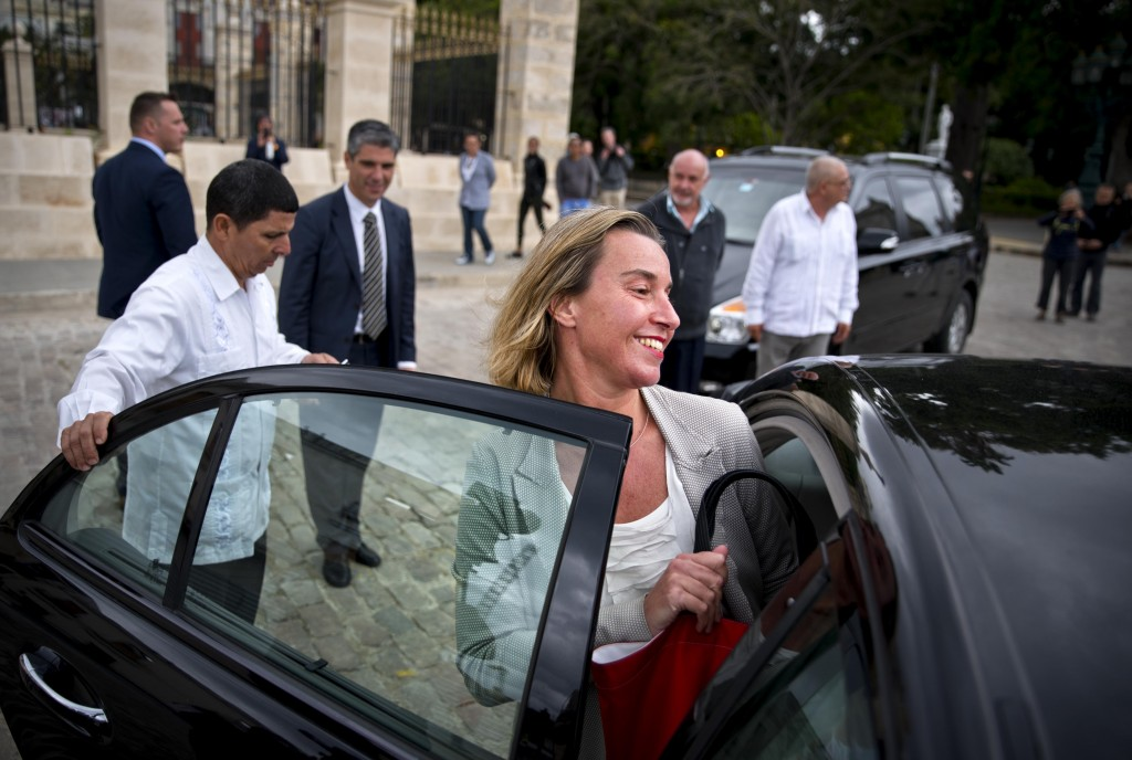 In this Jan. 4, 2018 photo, European Union High Representative Federica Mogherini, center, boards her official car after a press conference in Havana,