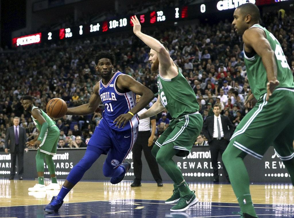 Philadelphia 76ers' Joel Embiid, left, and Boston Celtics' Aron Bynes in action during the NBA London Game 2018 at the O2 Arena in London, Thursday Ja