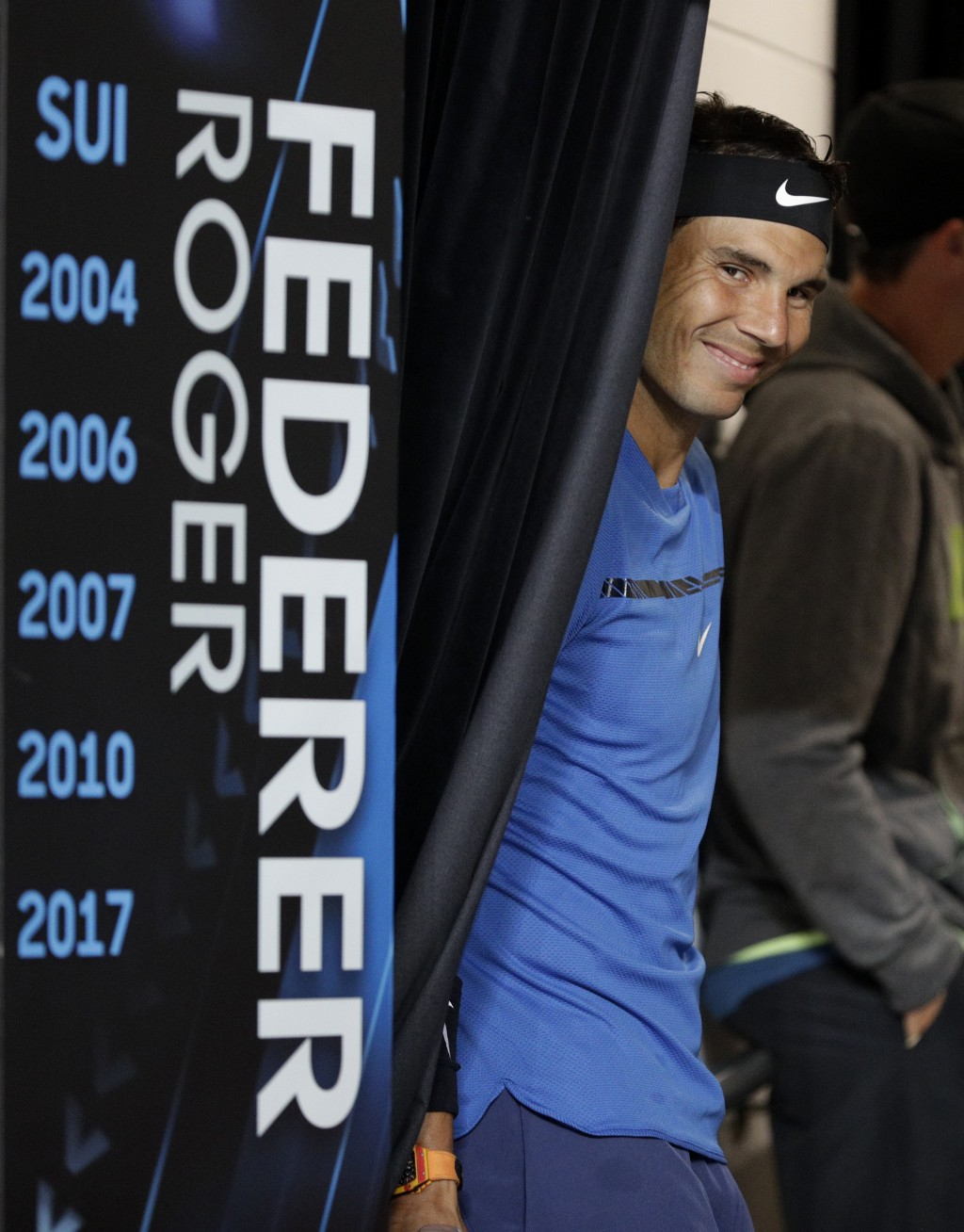 Spain's Rafael Nadal smiles as he waits to go on court for a practice match against Austria's Dominic Thiem on Margaret Court Arena ahead of the Austr