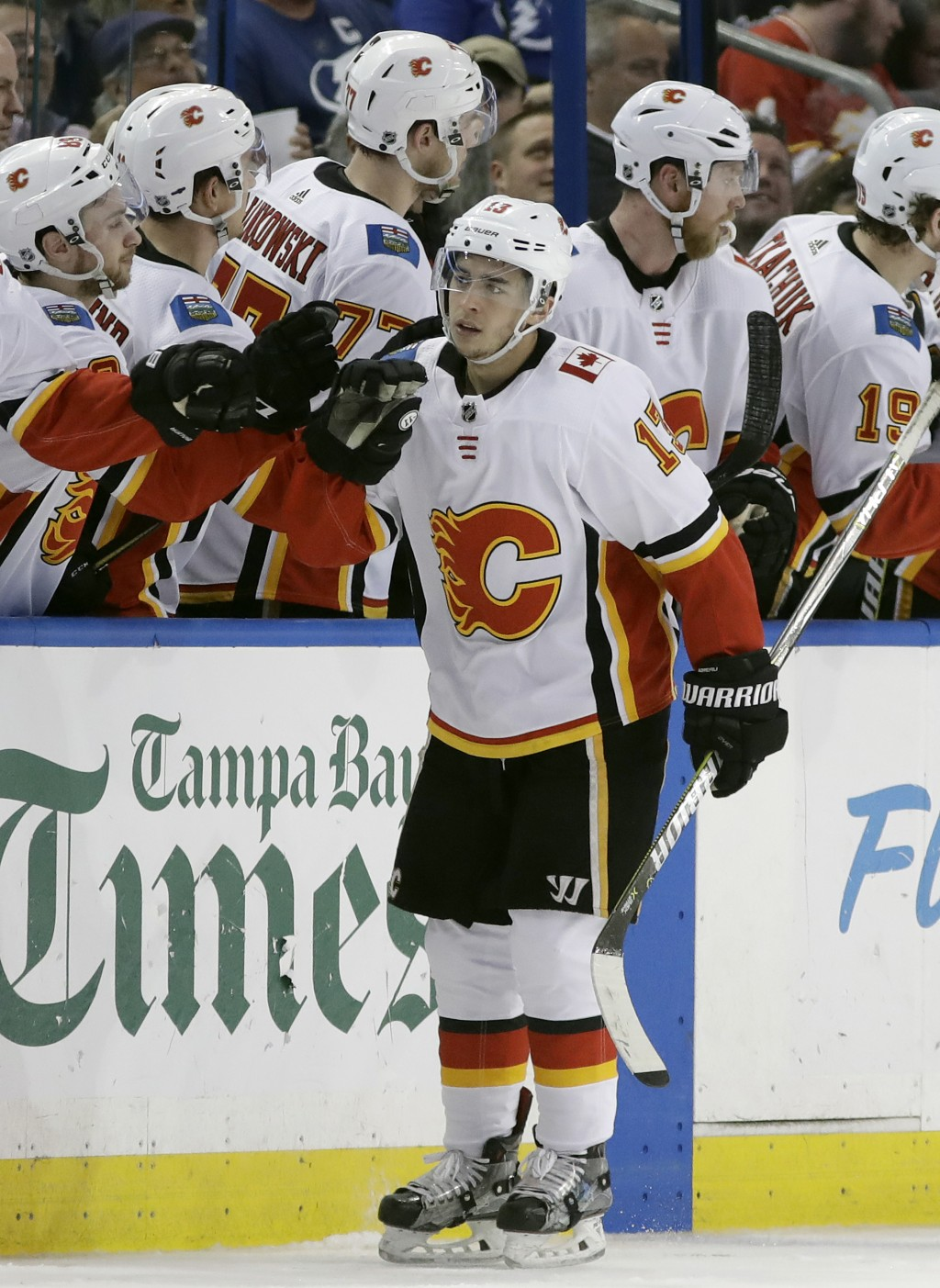 Calgary Flames left wing Johnny Gaudreau (13) celebrates with the bench after his goal against the Tampa Bay Lightning during the second period of an
