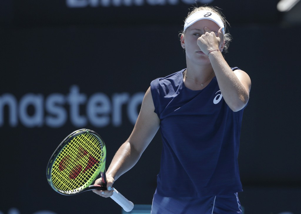 Daria Gavrilova of Australia points to her head while playing compatriot Ash Barty during their women's semifinal singles match at the Sydney Internat