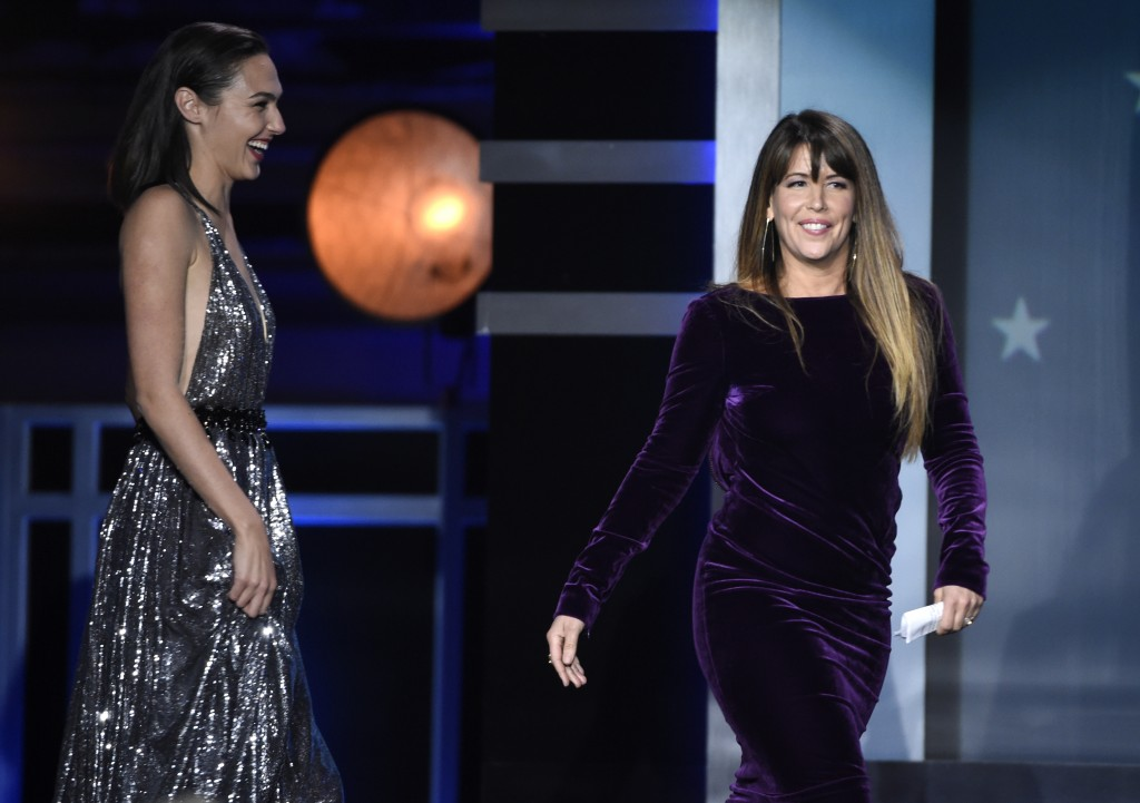 """Gal Gadot, left, and Patty Jenkins walk on stage to accept the award for best action movie for """"Wonder Woman"""" at the 23rd annual Critics' Choice Award"""