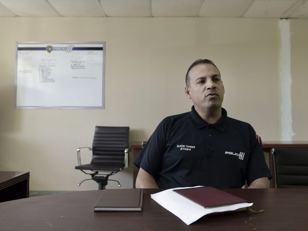 In this Tuesday, Jan. 9, 2018 photo, inspector Elexis Torres, speaks during an interview in Carolina, Puerto Rico. Torres heads a unit that is investi